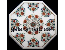 A different design semi-precious stones inlay table top of Makrana marble